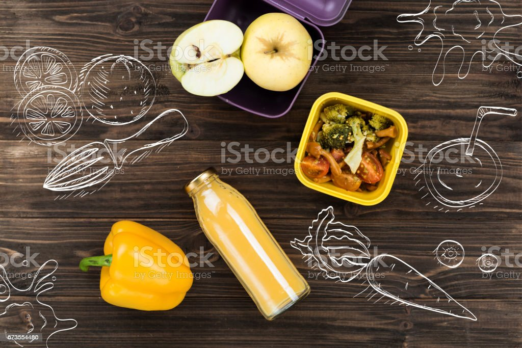 Bottle with smoothie lying on the wooden table royalty-free stock photo