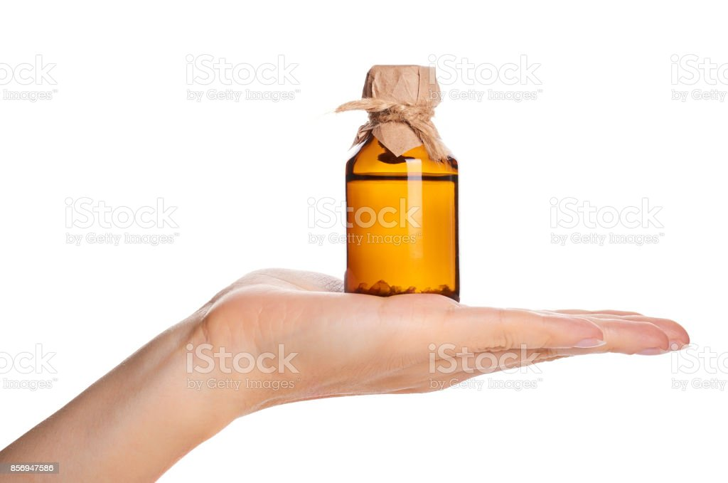 bottle with tincture in hand isolated on white background stock photo