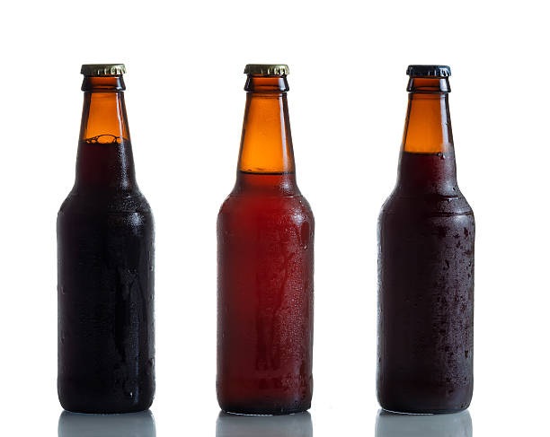 bottled fresh cold beer - dark beer stock photos and pictures