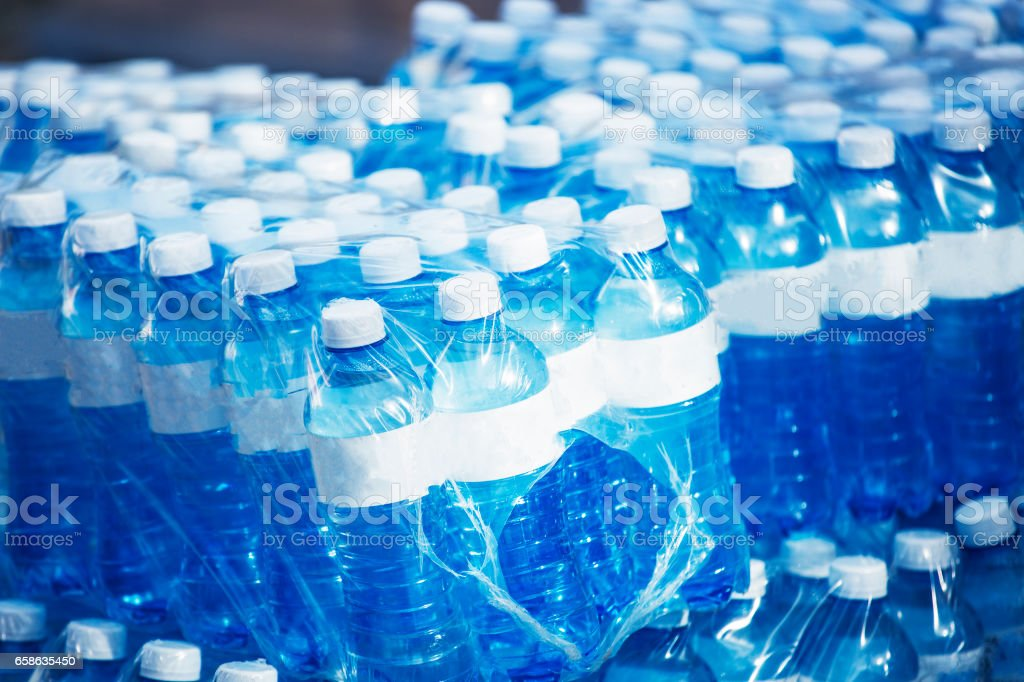 Bottled mineral water wrapped on plastic stock photo