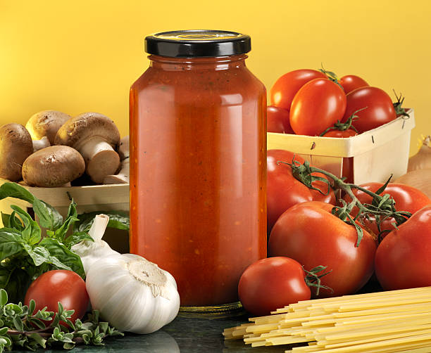Bottled pasta sauce with raw ingredients  burwellphotography stock pictures, royalty-free photos & images