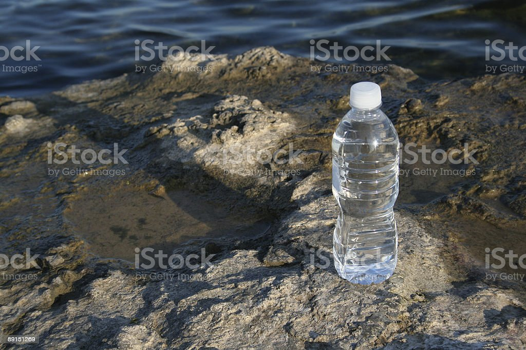 Bottled Water and Earth stock photo