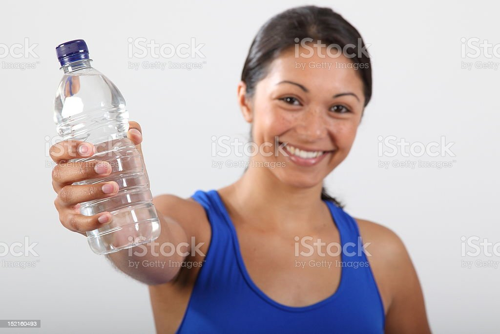 Bottled water held by beautiful smiling young woman royalty-free stock photo