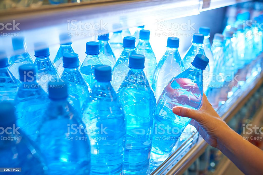 Bottled water on shelf in supermarket stock photo