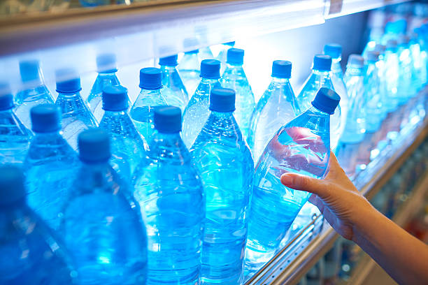 Bottled water on shelf in supermarket stock photo