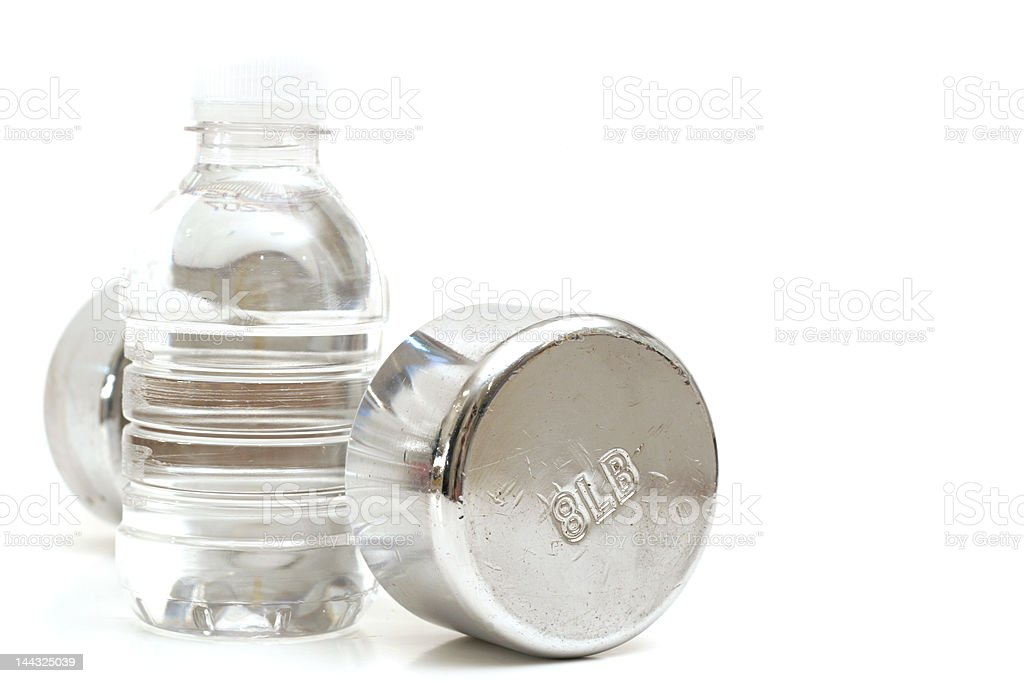 Bottled water with fitness weight royalty-free stock photo