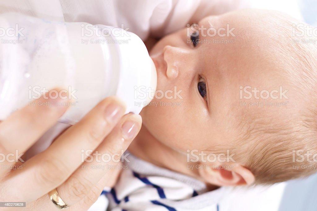 Bottle-fed baby stock photo