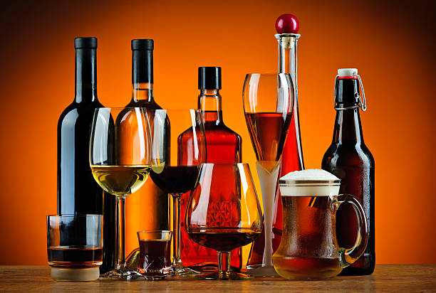 bottles and glasses of alcohol drinks - beer alcohol stock pictures, royalty-free photos & images