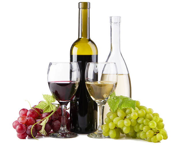 Bottles and glasses of red and white wines with grapes stock photo