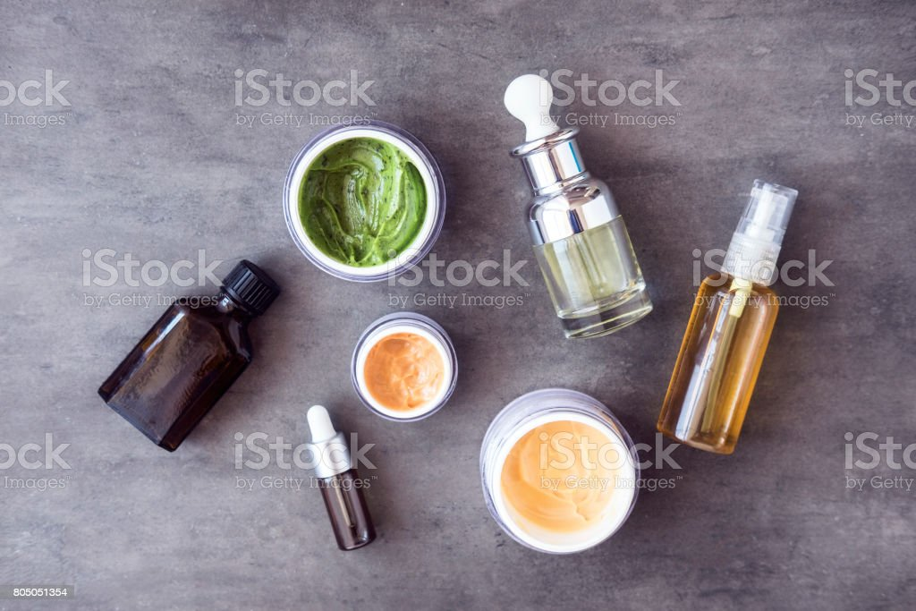 Bottles and jars with natural cosmetics stock photo