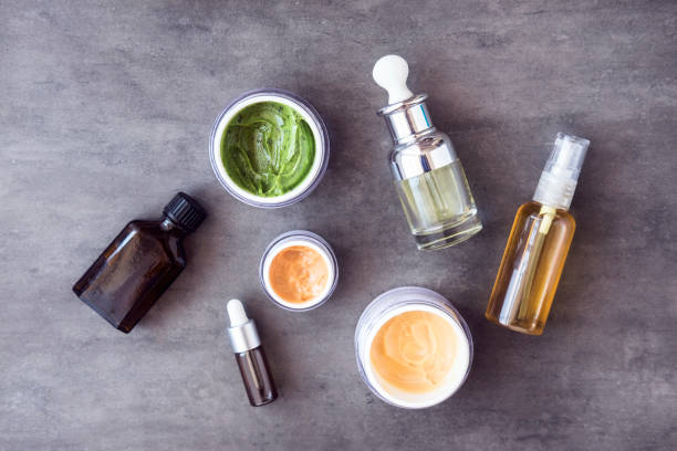 bottles and jars with natural cosmetics - serum stock photos and pictures