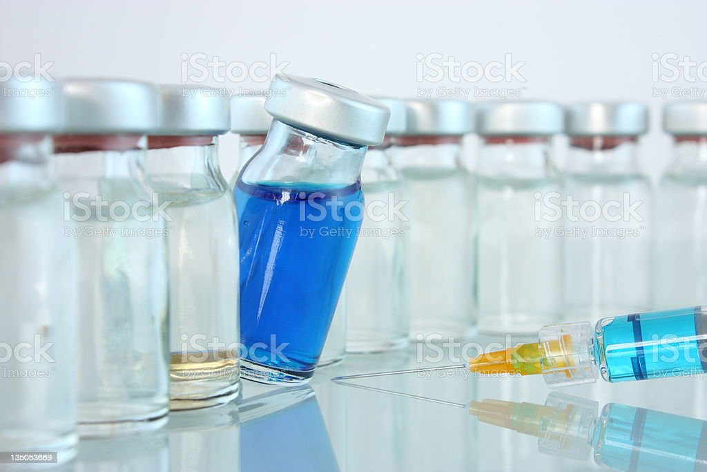 Bottles and syringe royalty-free stock photo
