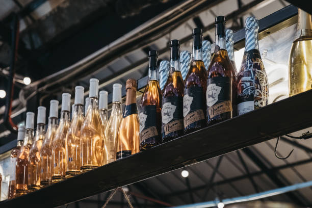Bottles at Cocktail Bar in Mercato Metropolitano market in London, UK. London, UK - November 2, 2018: Bottles at Cocktail Bar in Mercato Metropolitano, the first sustainable community market in London focused on revitalising the neighbourhood and protecting environment. mercato stock pictures, royalty-free photos & images