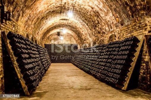 champagne (cava) bottles maturing in cellar