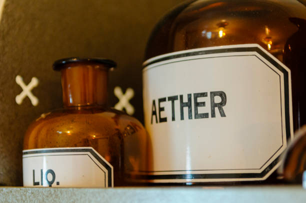 Bottles, including aether (ether) anaesthetic on shelves within a doctor's surgery from WW1. Bottles, including aether (ether) anaesthetic on shelves within a doctor's surgery from WW1. 1910 1919 stock pictures, royalty-free photos & images