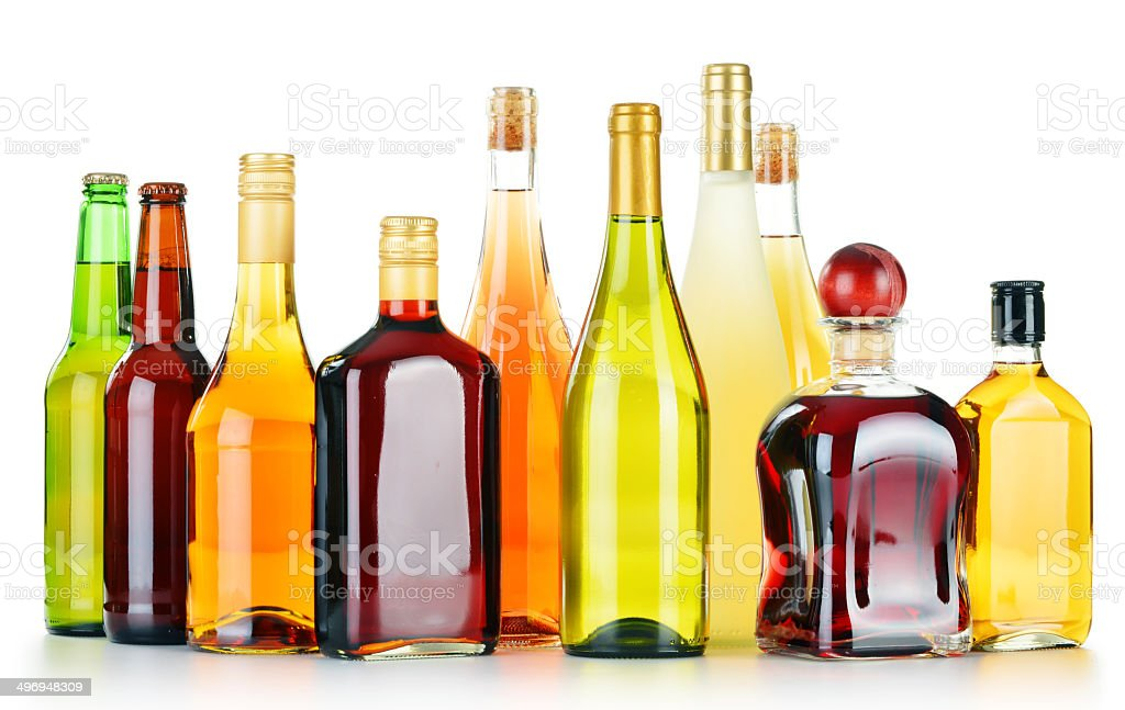 Bottles of assorted alcoholic beverages isolated on white stock photo