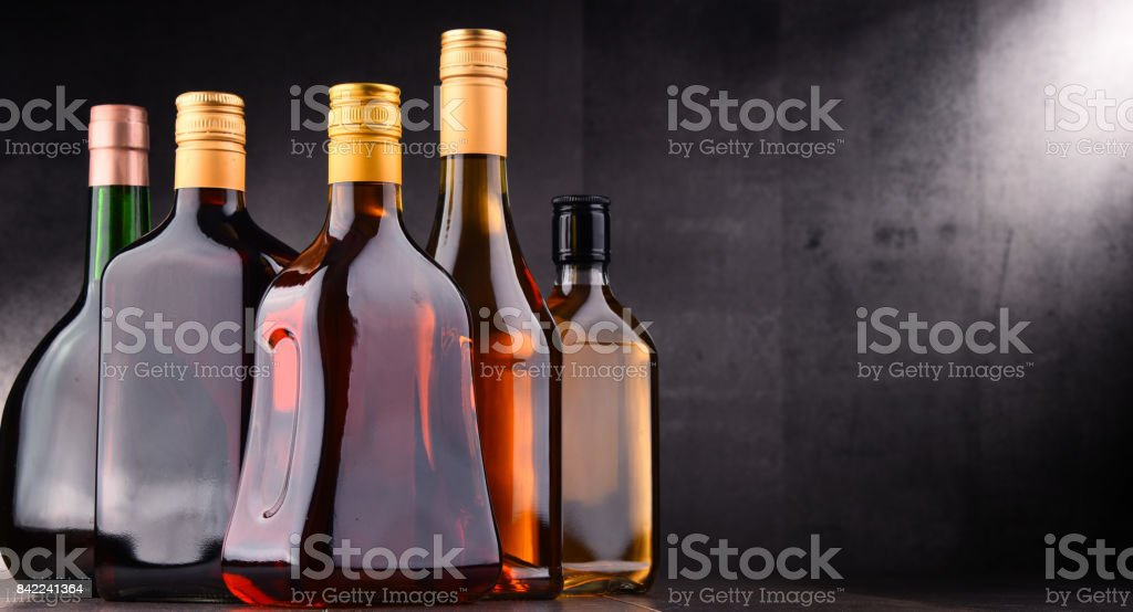 Bottles of assorted alcoholic beverages stock photo