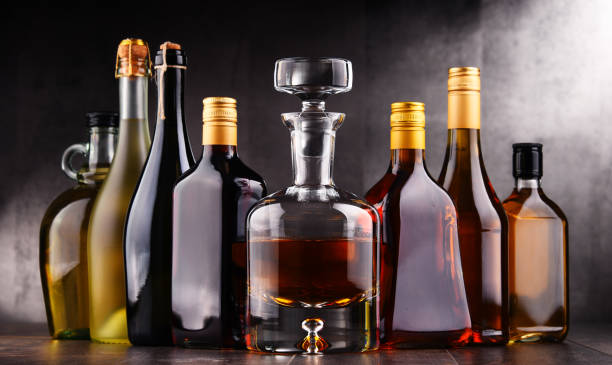 Bottles of assorted alcoholic beverages - foto stock