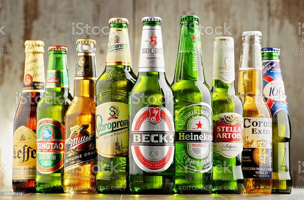 Bottles of assorted global beer brands stock photo