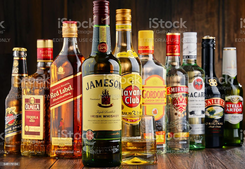 Bottles Of Assorted Hard Liquor Brands Stock Photo & More