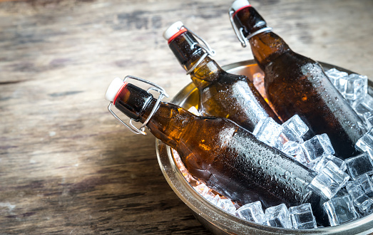 istock Bottles of beer in ice cubes 540120590