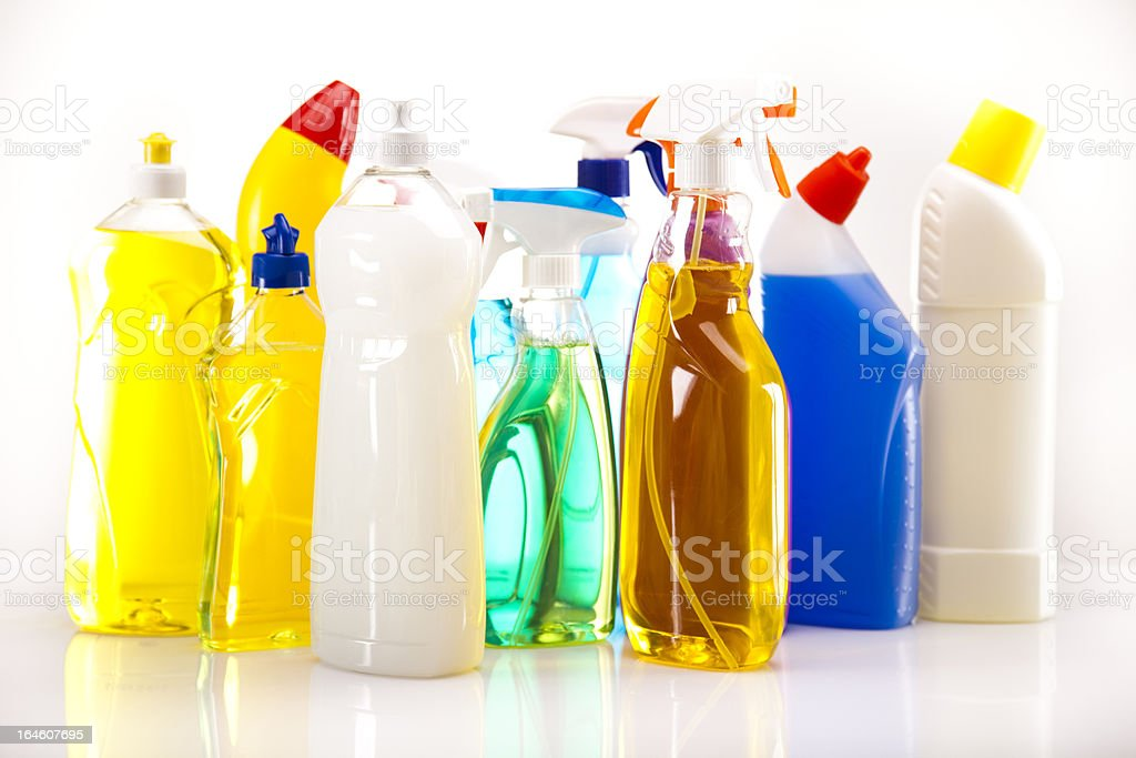 Bottles of cleaning fluids on a white surface stock photo