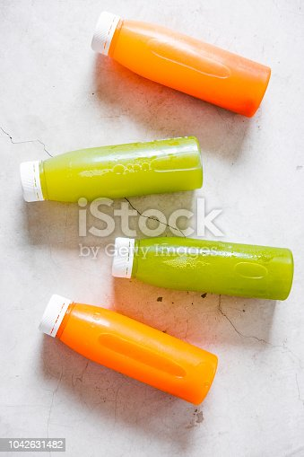 istock Bottles of cold pressed unprocessed juices 1042631482