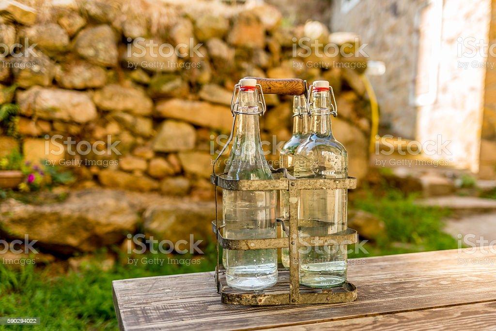 Bottles of cold spring water during summer - 1 royaltyfri bildbanksbilder