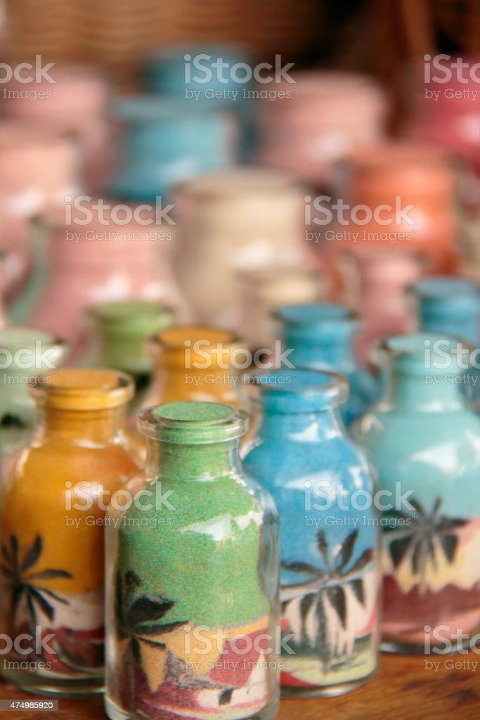 Bottles of coloured sands stock photo