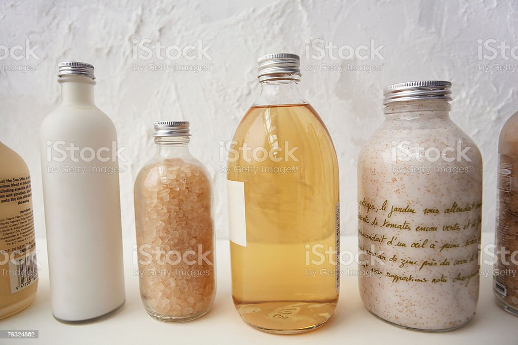 Bottles of cosmetics in a row stock photo