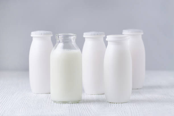 bottles of drink yogurt, homemade and traditional stock photo