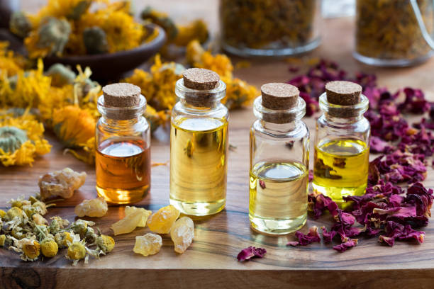 Bottles of essential oil with dried rose petals chamomile calendula picture id900990692?b=1&k=6&m=900990692&s=612x612&w=0&h=weertjxavgisozecy8chjl y6ifqhivcd46pvcoo9rc=