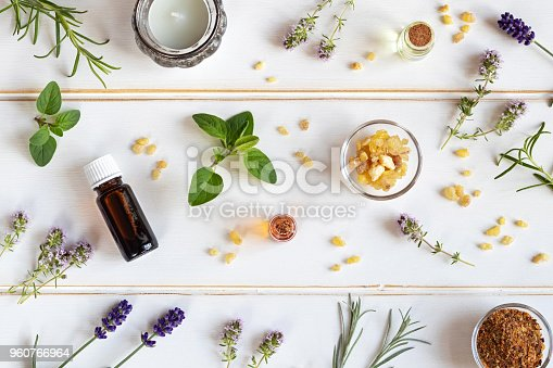 istock Bottles of essential oil with frankincense, lavender, thyme and other fresh herbs 960766964