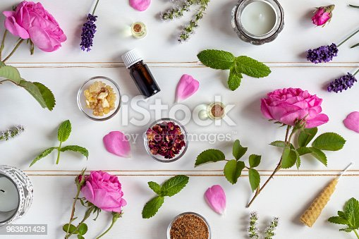 istock Bottles of essential oil with roses, peppermint, lavender, frankincense, thyme, myrrh 963801428