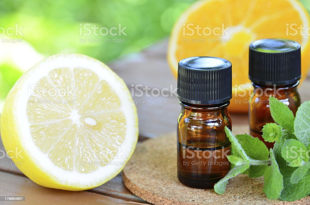 Bottles of essential oils with fruits stock photo