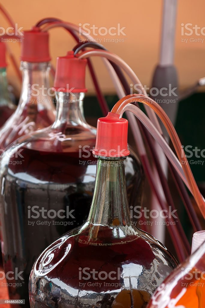 Bottles of glass with red wine stock photo