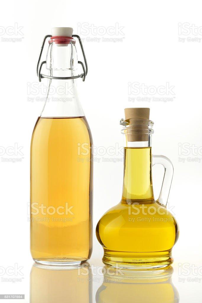 Bottles of Groundnut oil and Apple Cider Vinegar stock photo