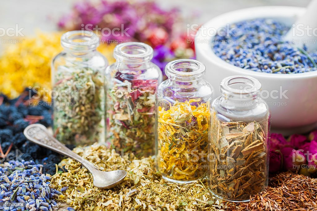 Bottles of healing herbs and mortar with dry lavender flowers stock photo