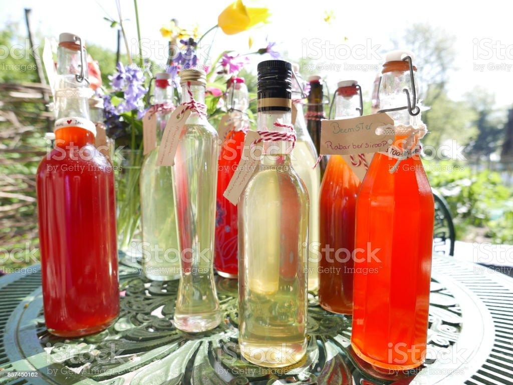 Bottles of home made organic juice stock photo