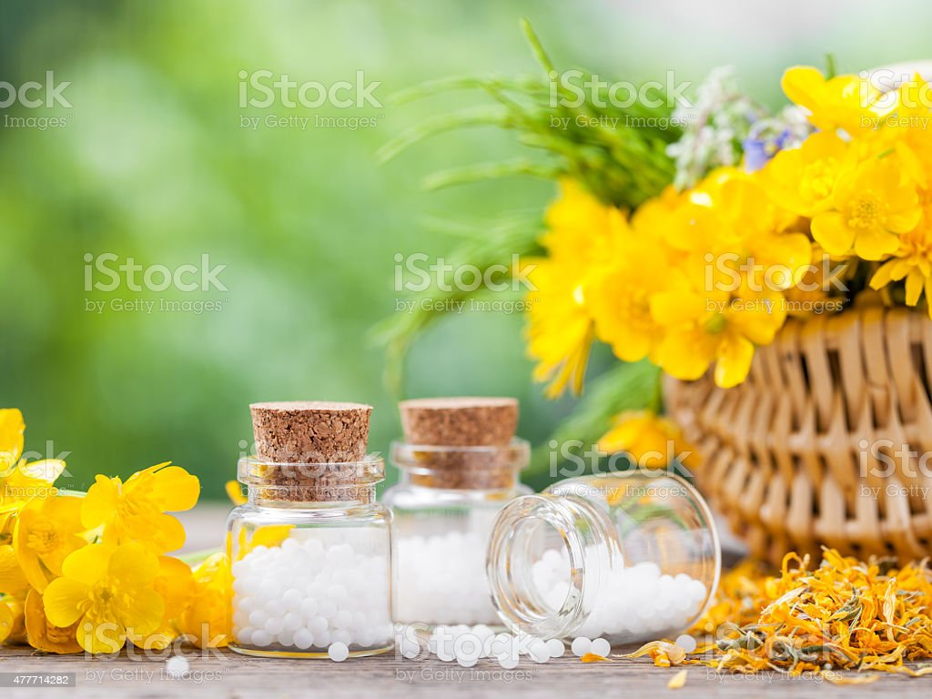 Bottles of homeopathy globules stock photo