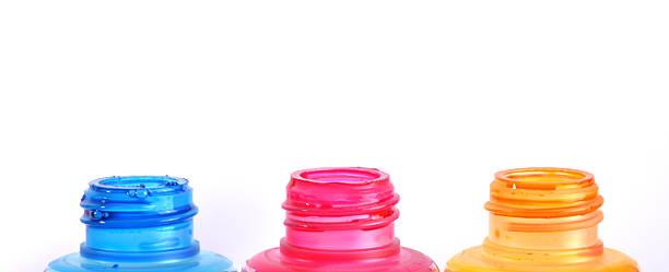 bottles of ink printer cartridges on white background. - munition nachfüllen stock-fotos und bilder