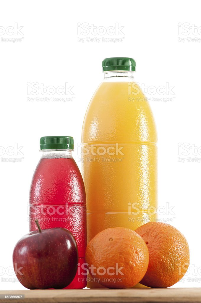 Bottles of juice and fruit royalty-free stock photo