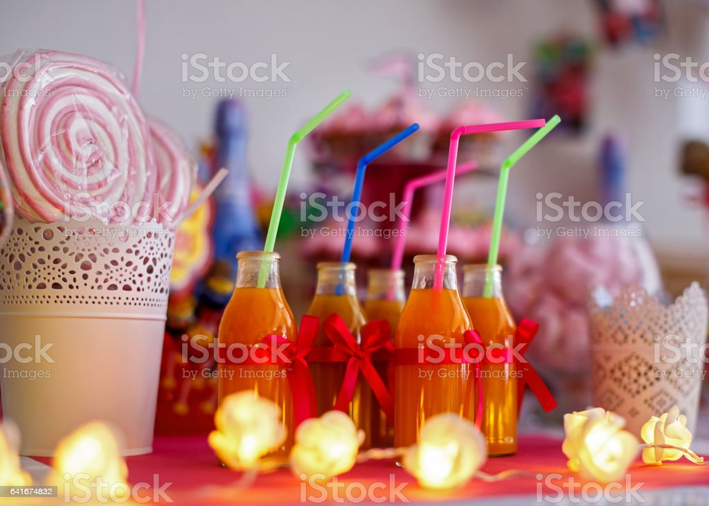 Bottles of juice decorated for kids stock photo