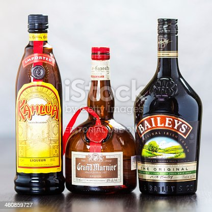 Zagreb, Croatia - December 29, 2013: Bottles of coffee liqueur Kahlua, triple sec Grand Marnier and Bailey's Irish Cream, which in equal parts form the known B-52 cocktail, usually served layered in a shot glass.