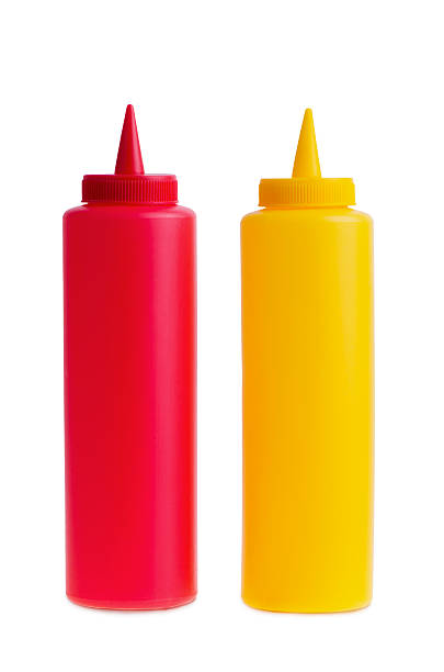 bottles of ketchup and mustard. - ketchup bottle stock photos and pictures