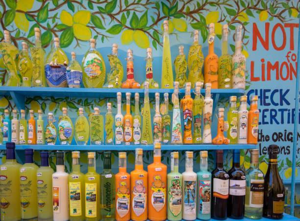 Bottles of Limoncello and arancello liquor in a souvenir shop in Sorrento Italy stock photo