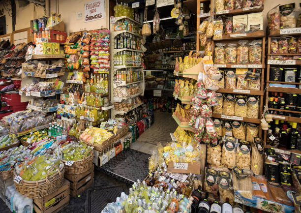 Bottles of Limoncello and Italian culinary specialties  in a souvenir shop in Sorrento Italy