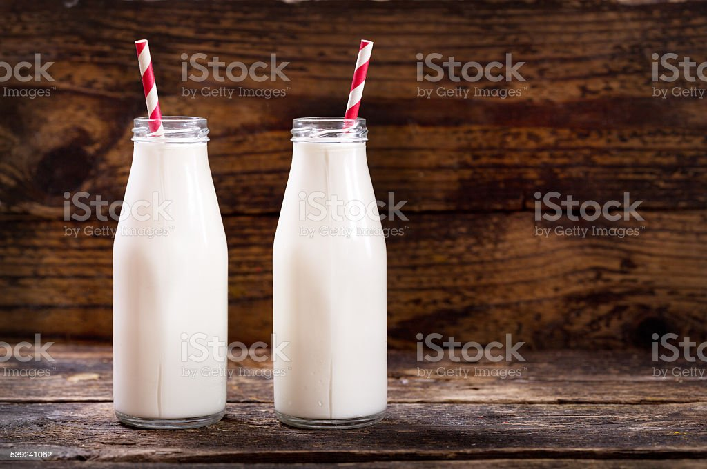 bottles of milk with straws royalty-free stock photo