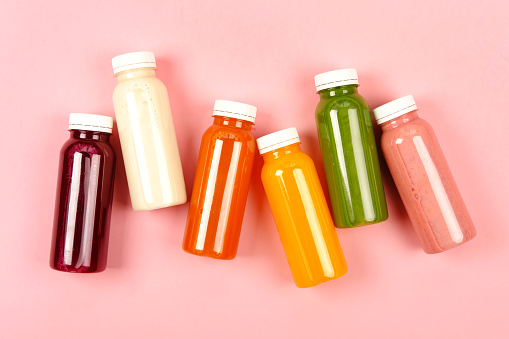 istock Bottles of multicolored smoothies 1034842510