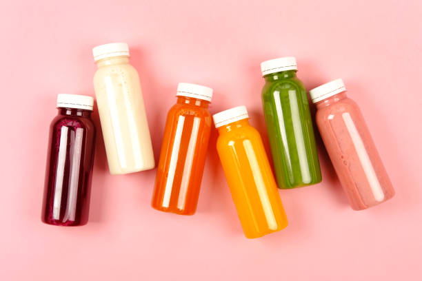 Bottles of multicolored smoothies stock photo